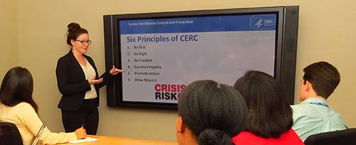 A CERC trainer explains the 6 principles of CERC during a training.