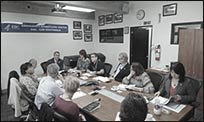 A group of public health professionals at a meeting of various CDC partners