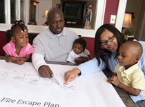 Photo of family sitting together at table with preparedness plan.