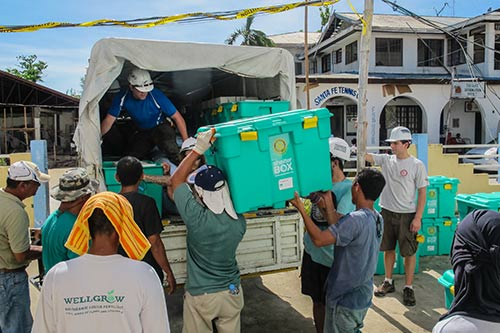 •	Volunteers loading supplies for shelters onto a truck after a disaster.