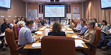 a group of leaders meeting inside CDC's Emergency Operations Center