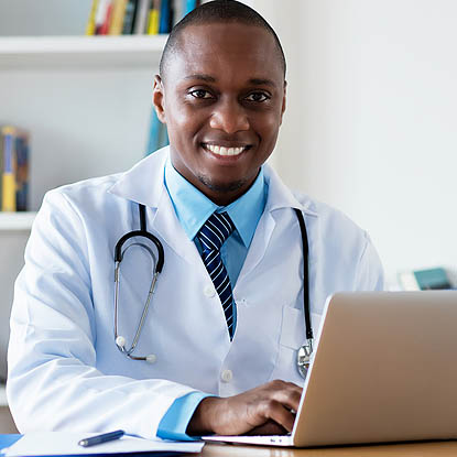 a doctor at his computer watching a webinar