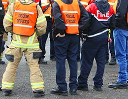 A group of emergency responders meeting in a huddle
