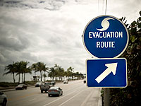 Photo of an evacuation route sign along side a highway