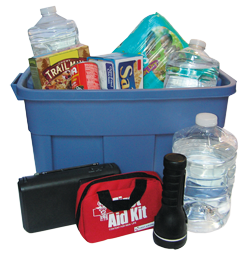 A storage box of emergency supplies including a first aid kit, flashlight, water bottles, and crackers.