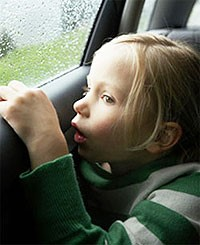 Little girl staring out the car window