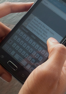 Person sending text to emergency point of contact.